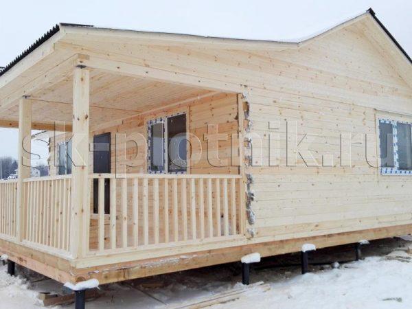 Дом из бруса с террасой 6х9 м